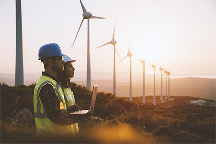 Workers at a wind farm