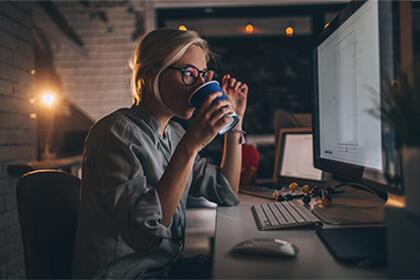 A woman looking at a comnputer